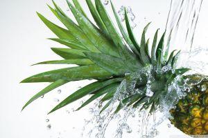 water splashes white background fruit pineapples