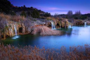 waterfall landscape nature lake evening shrubs trees spain village hills
