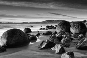 waves landscape new zealand water rock nature monochrome clouds hills sand coast beach trees sea