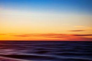 waves sea blurred horizon sunrise