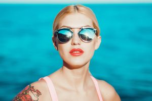 white blonde red lipstick blue sunglasses red