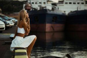 white clothing model kseniya white tops bare shoulders tanned skirt closed eyes ship long hair open mouth dock sitting blonde women