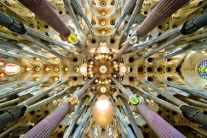 window worm's eye view architecture arch symmetry cathedral sagrada familia mosaic interior barcelona spain rooftops pillar
