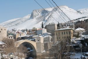 winter old bridge snow river mostar bosnia and herzegovina