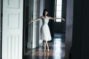 women ballerina white dress black hair dancing