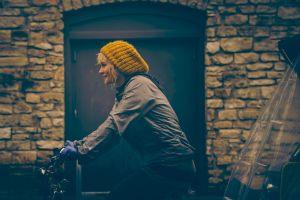 women blonde woolly hat bicycle