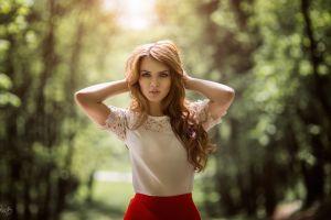 women blue eyes hands in hair women outdoors forest sunlight depth of field looking at viewer open mouth redhead long hair