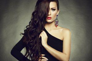 women brunette bare shoulders black dress red lipstick hair in face long hair green eyes