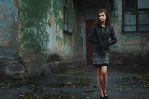 women brunette model looking away ivan kopchenov leather jackets sneakers black skirts