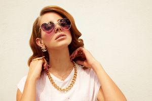 women celebrity singer sunglasses brunette jewelry simple background lana del rey