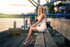 women high heels blue eyes minidress blonde dress model pier bench sitting pierced nose