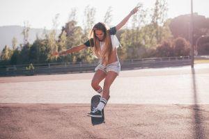 women hills jean shorts sports women outdoors open mouth jumping model long hair street traffic lights socks trees brunette skateboarding