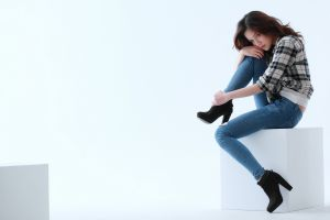 women jeans plaid shirt white background looking at viewer sitting high heels auburn hair brown eyes