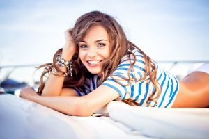women lying down smiling auburn hair blue eyes lying on front anna moryachka konchakovskaya bracelets striped t-shirt long hair