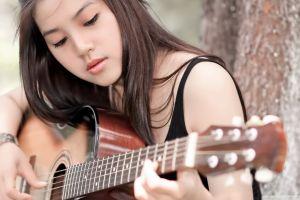 women outdoors brunette asian guitarist portrait eyeliner women