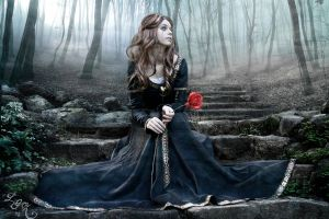 women outdoors crying women blue dress costumes conceptual looking away sadness tears long hair brunette