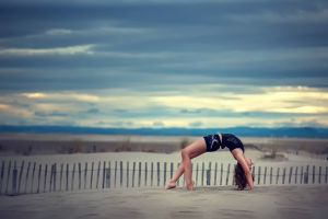 women outdoors sand gymnastics