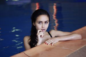 women portrait wet body face wet hair swimming pool finger in mouth