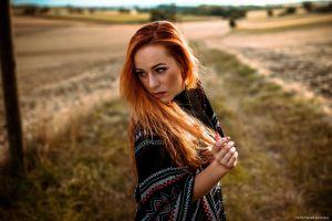 women redhead portrait looking away women outdoors
