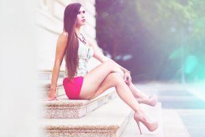women sitting short skirt juicy lips high heels ladders legs crossed legs looking into the distance women outdoors