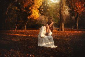 women tj drysdale long hair brunette women outdoors fall trees hands in hair squatting closed eyes profile