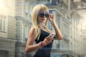 women with glasses women blonde portrait cellphone