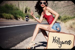 women with shades sitting red tops high heels red lipstick brunette tank top hitchhikers short shorts hollywood women jean shorts torn clothes