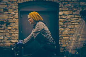woolly hat bicycle blonde women