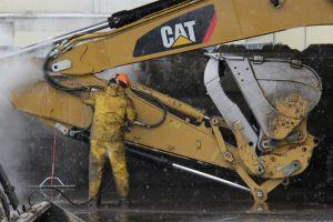 workers excavators construction vehicles